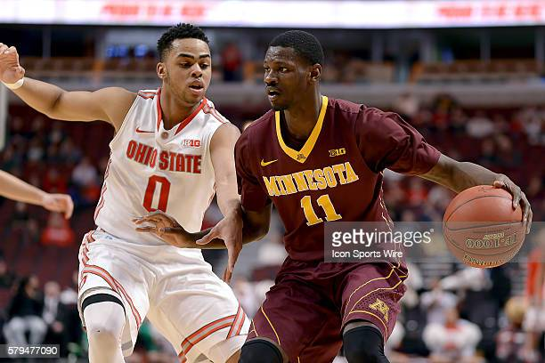Minnesota Golden Gophers guard Carlos Morris battles with Ohio State Buckeyes guard D'Angelo Russell in action during a game between the Ohio State...