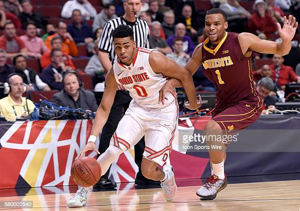 Ohio State Buckeyes guard D'Angelo Russell battles with Minnesota Golden Gophers guard Andre Hollins in action during a game between the Ohio State...