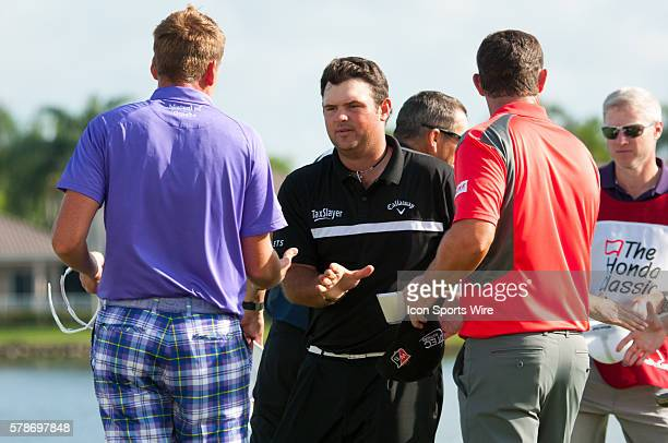 Patrick Reed Texas shakes hands with Padraig Harrinton Ireland Ian Poulter England in The 18th Hole and the Third round of The Honda Classic at PGA...
