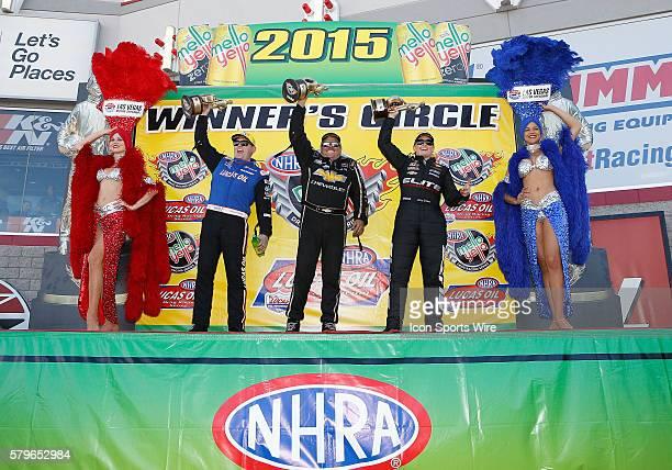 Richie Crampton NHRA Top Fuel Dragster John Force Chevrolet Camaro NHRA Funny Car and Erica EndersStevens Chevrolet Camaro NHRA Pro Stock celebrate...