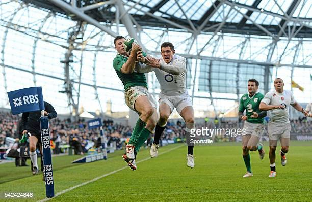 March 2015; Robbie Henshaw, Ireland, catches a high ball against Alex Goode, England, before touching down for the first try of the game. RBS Six...