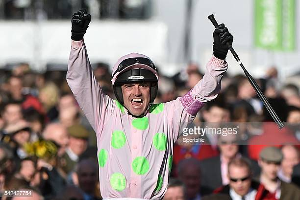 10 March 2015 Ruby Walsh celebrates as he's led into the winner's enclosure after victory in the Champion Hurdle on Faugheen Cheltenham Racing...