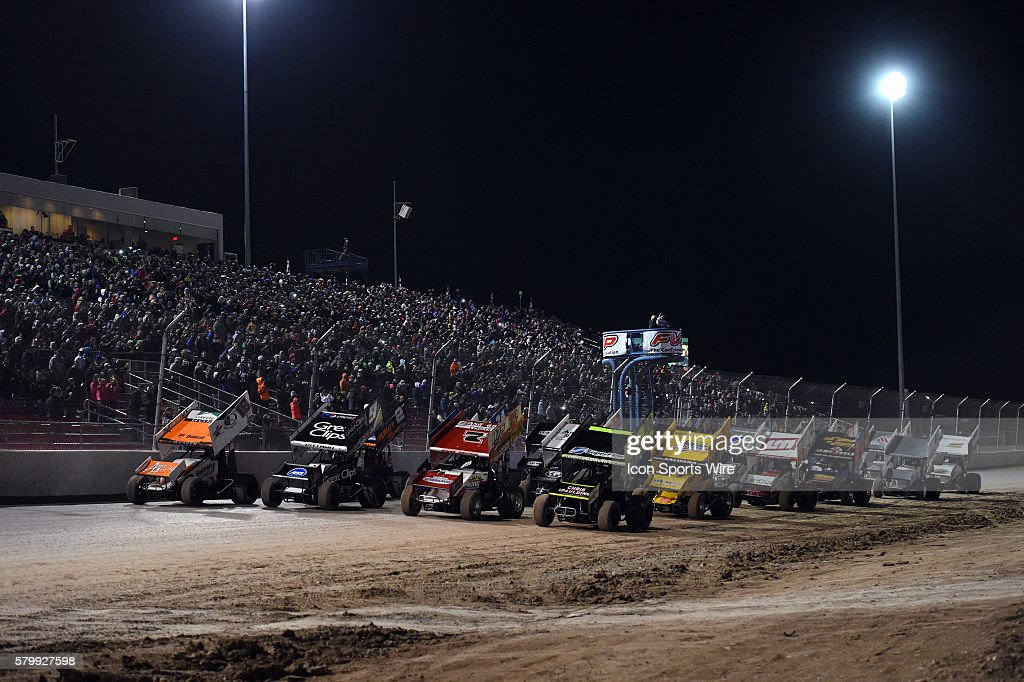 Terry McCarl (24) leads the field for the four-wide ceremonial pace lap at the beginning of the race during the feature event of the World of Outlaws FVP Outlaw Showdown at The Dirt Track at Las Vegas Motor Speedway in Las Vegas, NV.