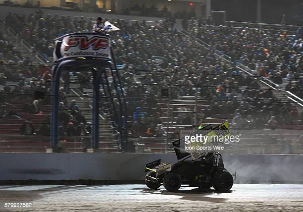 Terry McCarl takes the checkered flag during the feature event of the World of Outlaws FVP Outlaw Showdown at The Dirt Track at Las Vegas Motor...