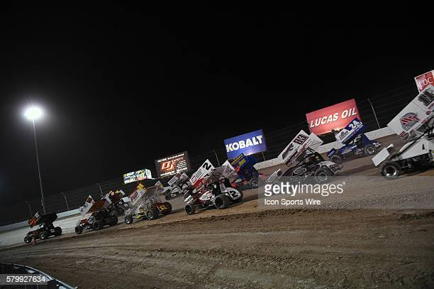 The pack rounds turn 4 for a restart during the feature event of the World of Outlaws FVP Outlaw Showdown at The Dirt Track at Las Vegas Motor...