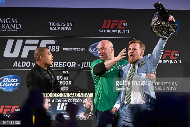 31 March 2015 UFC featherweight Conor McGregor right grabs the title belt from UFC featherweight Champion Jose Aldo during a fan event The Convention...