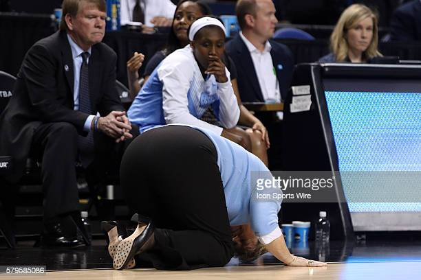 UNC head coach Sylvia Hatchell collapses to the ground in front of Jamie Cherry and assistant coach Andrew Calder The University of North Carolina...