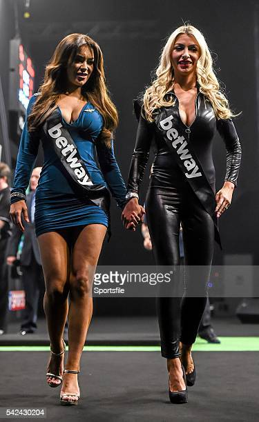 26 March 2015 Walkon girls Hazel O'Sullivan left and Maria Barbie at the 3Arena Dublin during the Betway Premier League Darts event Picture credit...