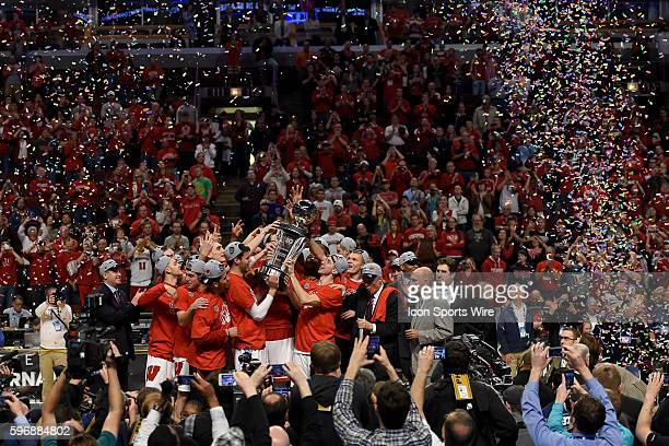 Wisconsin Badgers players celebrate by holding the Big Ten Championship trophy up in the air in action during Big Ten Championship game between the...