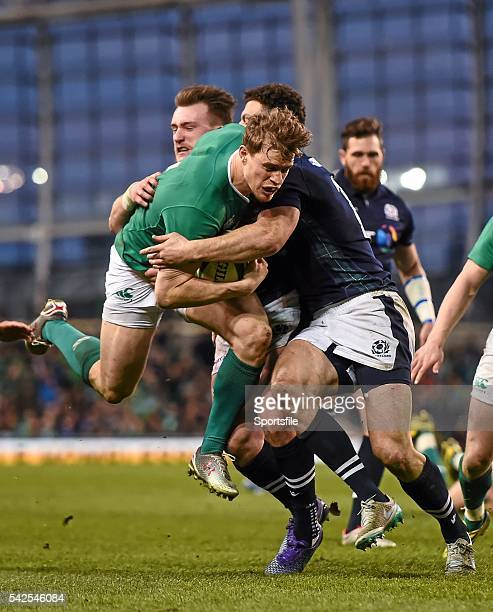 March 2016; Andrew Trimble, Ireland, is tackled by Duncan Taylor, Scotland. RBS Six Nations Rugby Championship, Ireland v Scotland. Aviva Stadium,...