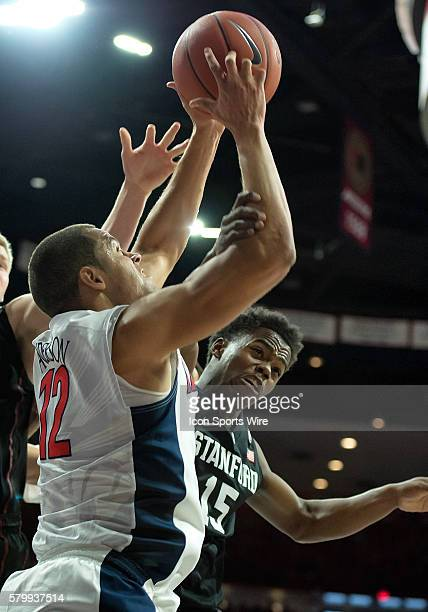 Arizona Wildcats forward Ryan Anderson and Stanford Cardinal guard Marcus Allen fight for a rebound during the NCAA basketball game between the...