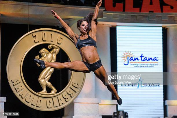 Caitlin Corry competes in Women's Fitness at the Arnold Amateur Bodybuilding Fitness Figure Bikini and Physique Championships as part of the Arnold...