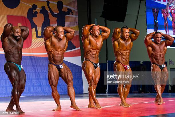 Charles Dixon David Henry Guy Cisternino Hidetada Yamagishi and Jose Raymond compete in prejudging for the Arnold Classic 212 as part of the Arnold...
