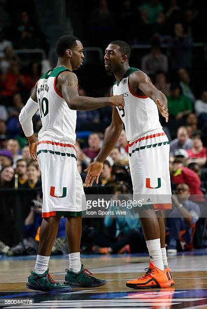 G Sheldon McClellan of the Miami Hurricanes congratulates G Davon Reed of the Miami Hurricanes after the game The Miami Hurricanes defeated the...