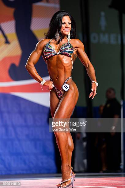 Julie Mayer competes in prejudging for Figure International as part of the Arnold Sports Festival at the Greater Columbus Convention Center in...