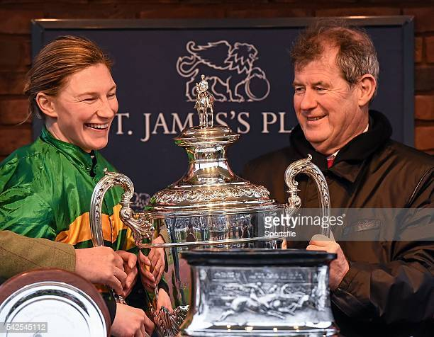 18 March 2016 Nina Carberry and Owner JP McManus with the Foxhunter Trophy after winning the St James's Place Foxhunter Steeple Chase Challenge Cup...