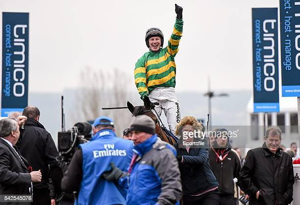 18 March 2016 Nina Carberry celebrates winning the St James's Place Foxhunter Steeple Chase Challenge Cup on On The Fringe Prestbury Park Cheltenham...