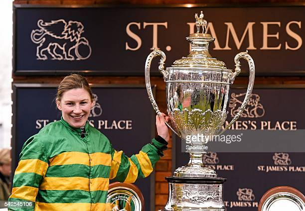 18 March 2016 Nina Carberry with the Foxhunter Trophy after winning the St James's Place Foxhunter Steeple Chase Challenge Cup on On The Fringe...
