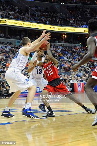 North Carolina State Wolfpack guard Anthony Barber is fouled by Duke Blue Devils guard Matt Jones in the second round game of the ACC Tournament at...