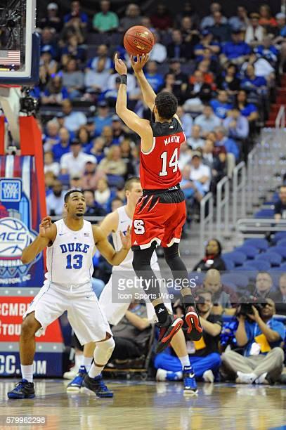 North Carolina State Wolfpack guard Caleb Martin scores against Duke Blue Devils guard Matt Jones in the second round game of the ACC Tournament at...