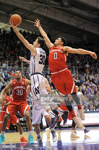 Northwestern Wildcats guard Bryant McIntosh goes up for a shot against Nebraska Cornhuskers guard Tai Webster during a game between the Nebraska...