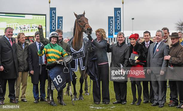 18 March 2016 On The Fringe Jockey Nina Carberry Trainer Enda Bolger behind her owner JP McManus sixth from right and the winning connections of the...