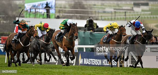 18 March 2016 On The Fringe with Nina Carberry up centre with white cap on their way to winning the St James's Place Foxhunter Steeple Chase...