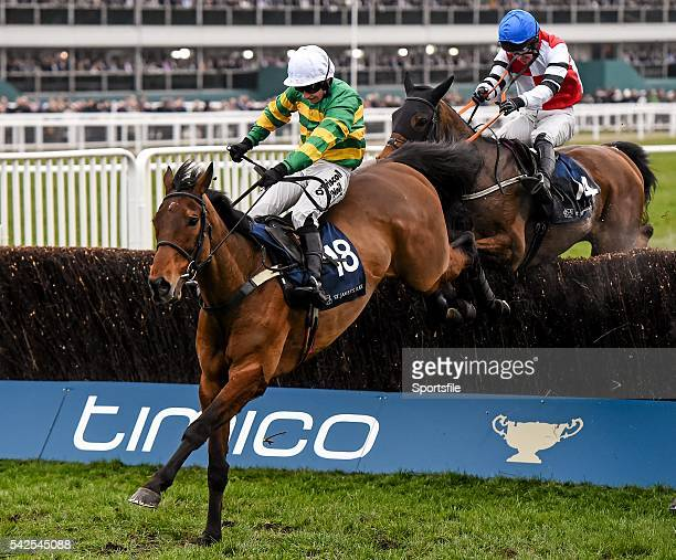 18 March 2016 On The Fringe with Nina Carberry up jump the last on their way to winning the St James's Place Foxhunter Steeple Chase Challenge Cup...