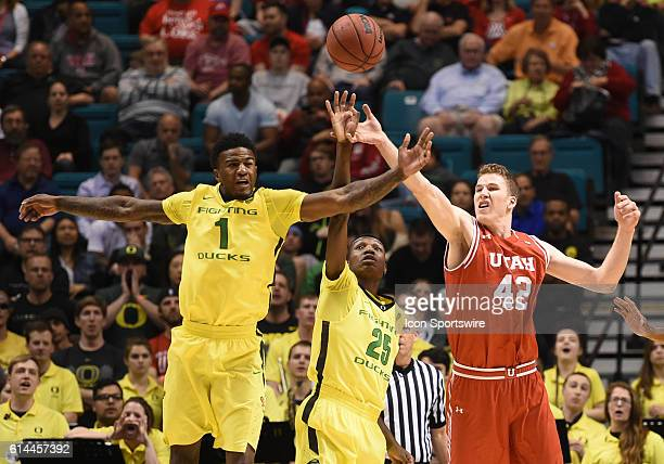 Oregon Jordan Bell and Oregon Chris Boucher steel the ball away from Utah Jakob Poeltl during the men's Pac12 Basketball Tournament championship game...