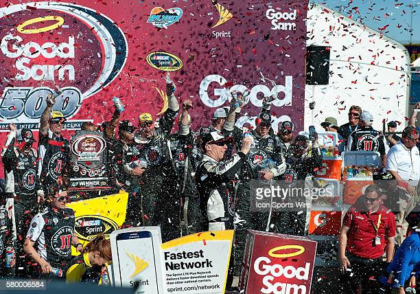 Sprint Cup Series driver Kevin Harvick celebrates in Victory Lane with his crew after winning the 12th annual Good Sam 500 NASCAR Sprint Cup Series...