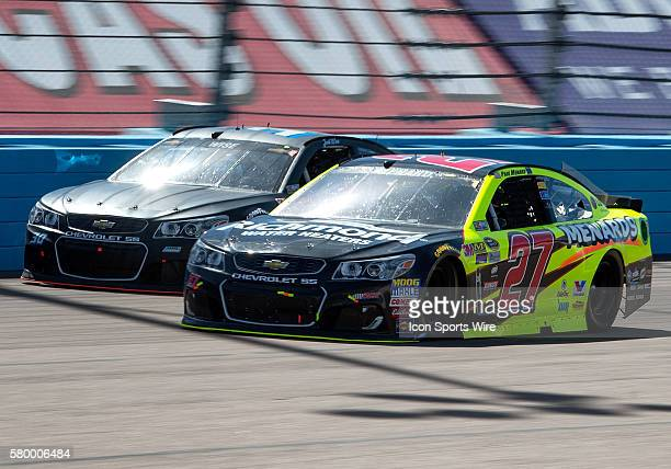Sprint Cup Series drivers Paul Menard and Josh Wise battle during the 12th annual Good Sam 500 NASCAR Sprint Cup Series race at Phoenix International...
