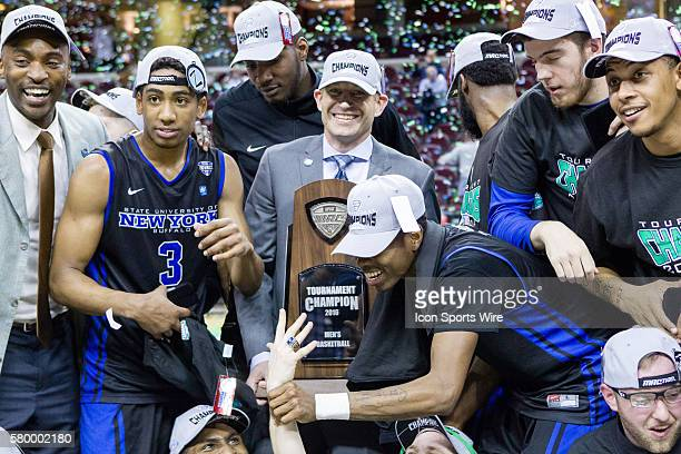 The Buffalo Bulls celebrate after winning the NCAA Men's MAC Tournament Championship Basketball game between the Buffalo Bulls and Akron Zips at...