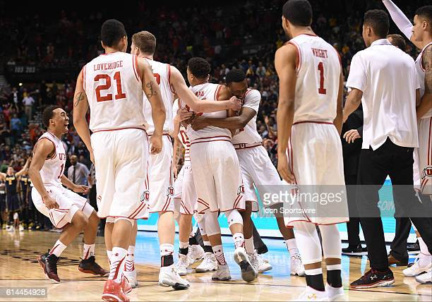 The Utah bench celebrates with Utah Lorenzo Bonam after hitting the game tying buzzer beater basket to send into overtime during the men's Pac12...