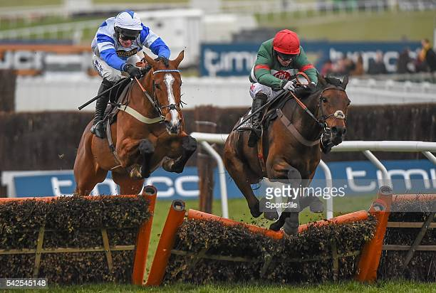 18 March 2016 Unowhatimeanharry right with Noel Fehily up jumps the last alongside Barters Hill with David Bass up on their way to winning the Albert...