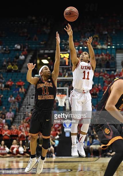 Utah Brandon Taylor shoots over USC Jordan McLaughlin during the men's Pac12 Basketball Tournament game between the USC Trojans and the Utah Utes at...