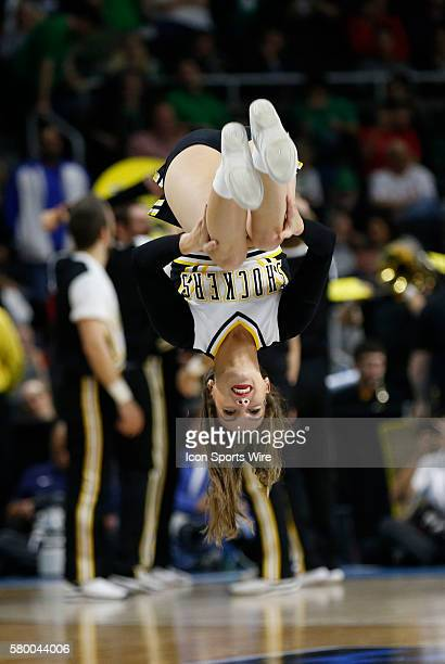 Wichita State Shockers cheerleader does a flip The Wichita State Shockers defeated the Arizona Wildcats 6555 in the first round of the NCAA Division...