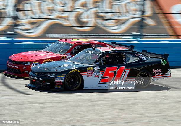 Xfinity Series drivers Ross Chastain and Jeremy Clements battle during NASCAR's Axalta Faster. Tougher. Brighter. 200 Xfinity Series race at the...
