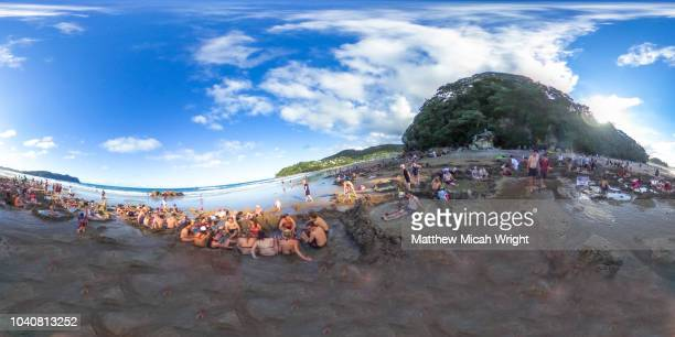 march 2017 - haihe, new zealand. tourists flock to the beach to dig holes in the sand to access the geothermal hot water that turns the beach into a natural spa. - equirectangular panorama stock pictures, royalty-free photos & images