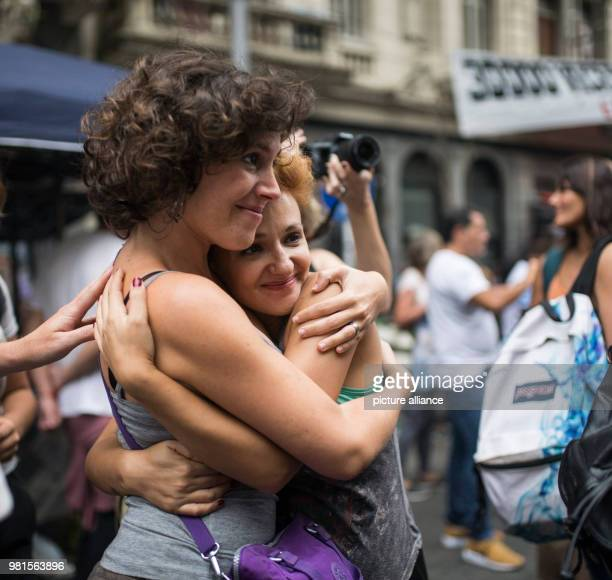 Two women embrance at a protest 42 years after the last military coup children and grandchildren of the torturers of the former miliary dictatorship...