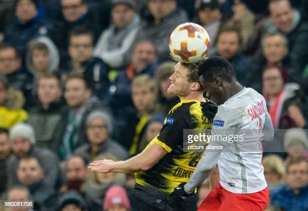Football Europa League RB Salzburg vs Borussia Dortmund at the Red Bull Arena Dortmund's Andre Schuerrle and Salzburg's Diadie Samassekou vie for the...