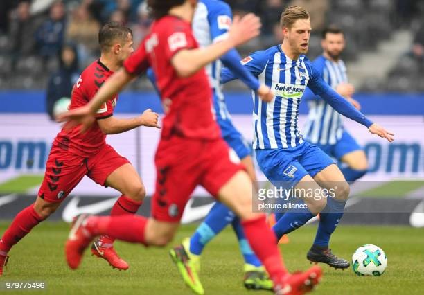 Bundesliga football Hertha BSC vs SC Freiburg at the Olympic Stadium Hertha's Arne Maier tries to get past Freiburg's defence Photo Soeren Stache/dpa...