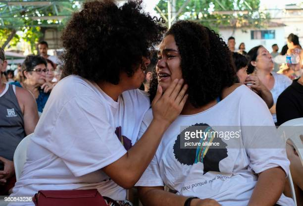 A family friend consoles Luyara Santos the daughter of Marielle Franco a leftwing politician and advocate against police violence Soon after Franco...
