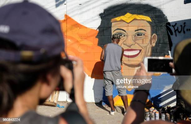 A street artist paints a portrait to commemorate the late Marielle Franco a leftwing politician and advocate against police violence Soon after...