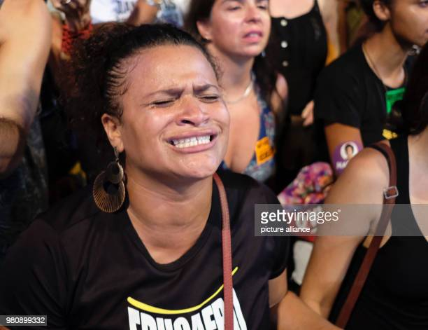 A woman mourns during a rally after the murder of the Brazilian politician and critic of police violence Franco The city council accused the police...