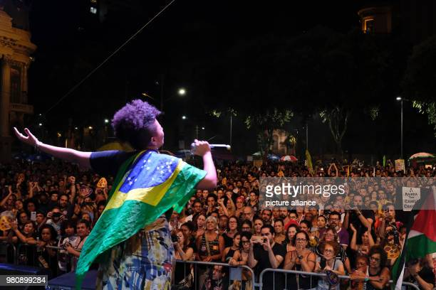 A woman performs on stage during a protest after the murder of the Brazilian politician and critic of police violence Franco The city council accused...