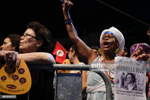 A woman shouts slogans during a rally after the murder of the Brazilian politician and critic of police violence Franco The city council accused the...