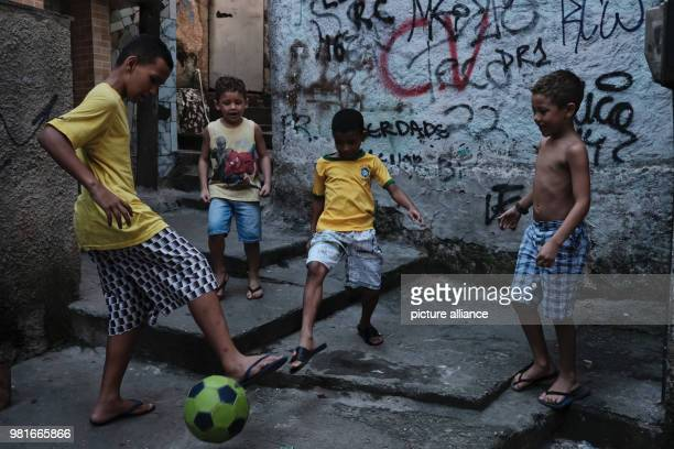 Children playing football in a street in the favela Rochina Photo Diego Herculano/dpa