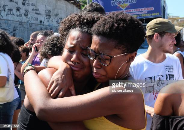 Two women crying at a demonstration against the murder of brazilian politician and critic of police violence Marielle Franco Unknown perpetrators...