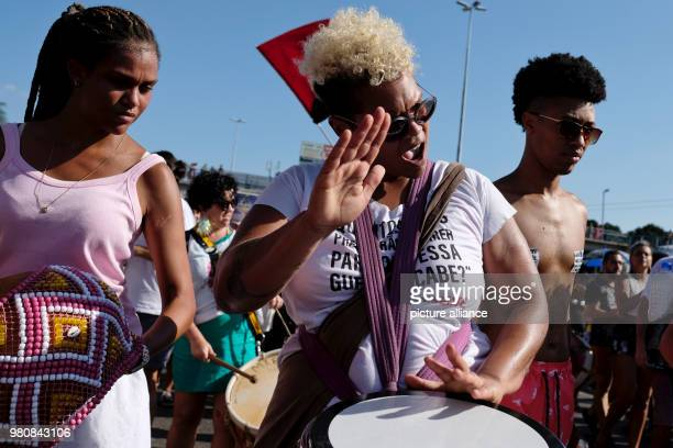 Women drumming at the demonstration agaisnt the murder of politician and critic of police violence Marielle Franco He is standing in front of a woman...