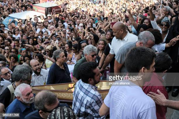 Crowds accompany the coffins of leftwing politician Marielle Franco and her driver who were murdered during the night of 1415 March Photo Diego...